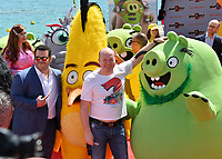 """CANNES, FRANCE. May 13, 2019:  Sonia Plakidyuk, Josh Gad & Sergey Burunov at the photocall for """"The Angry Birds Movie 2"""" at the Festival de Cannes.<br /> Picture: Paul Smith / Featureflash"""