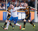 Kris Boyd and Michael Doyle engage in some mutula shirt pulling but the Rangers man is penalised