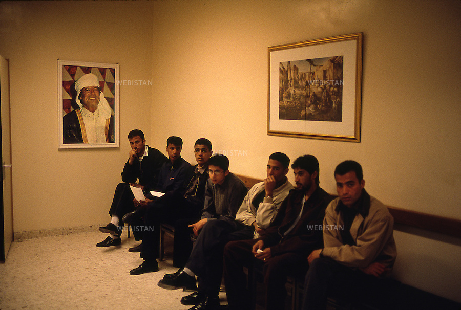 LIBYA, TRIPOLI-12/02/2000. Fine arts college administrative building. Students are waiting in the hall where there is a portrait of the Libyan leader Muammar Abu Minyar al-Gaddafi on the wall.<br /> <br /> LIBYE, TRIPOLI-12/02/2000. Bureau administratif des Beaux-Arts. Les etudiants attendent dans le hall dont les murs sont ornes de tableaux representant le leader Libyen Mouammar Abu Minyar Khadafi.
