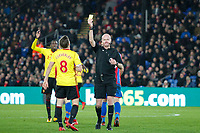 Referee Lee Mason shows Tom Cleverley of Watford a second yellow card  during the Premier League match between Crystal Palace and Watford at Selhurst Park, London, England on 12 December 2017. Photo by Carlton Myrie / PRiME Media Images.