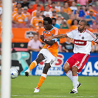 Chicago Fire defender C.J. Brown (2) moves in on Houston Dynamo forward Kei Kamara (10) as Kamara strikes the ball for a goal in the 21st minute.  Houston Dynamo defeated Chicago Fire 3-2  at Robertson Stadium in Houston, TX on August 9, 2009.