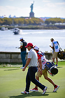 Patrick Reed (USA) walks down 14 with the Statue of Liberty on the horizon during round 3 Foursomes of the 2017 President's Cup, Liberty National Golf Club, Jersey City, New Jersey, USA. 9/30/2017.<br /> Picture: Golffile | Ken Murray<br /> <br /> All photo usage must carry mandatory copyright credit (&copy; Golffile | Ken Murray)