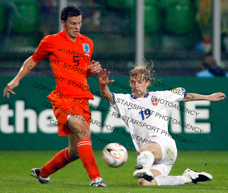 Serbia's Dusan Basta, right, in action against Holland's player Erik Pieters, left, during their UEFA U21 Championship final soccer match between The Netherlands and Serbia at the Euroborg stadium in Groningen, The Netherlands, Saturday June 23, 2007. Srdjan Stevanovic/starsportphoto.com)