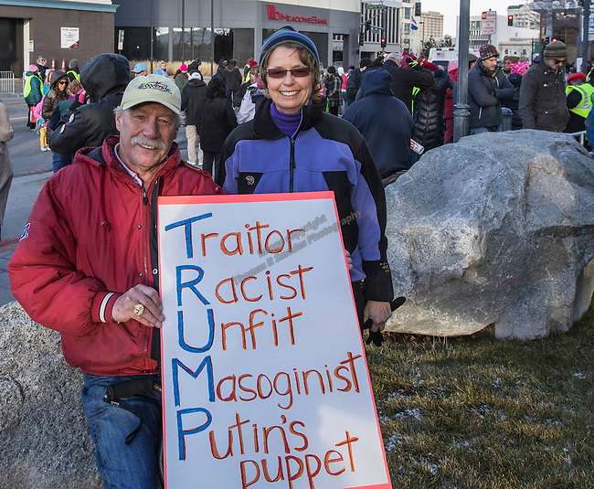 Jim and Peggy Henderson, from Reno, during the Reno Women's March on Washington event on Virginia Street in downtown Reno on Saturday, Jan. 21, 2017.