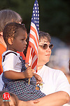 NAUGATUCK,CT-7/1/99-0701CK02.tif-Noah Cross age 2 of Waterbury sdtands with his mother Darlene Lupachino as they watch Ronald McDonald put oin a show at the Naugatuck fourth of July celebration at the highschool on Sunday.    CASEY KEIL PHOTO