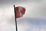 CANADIAN FLAG, TATTERED. KUGLUKTUK, NUNAVUT, CANADA