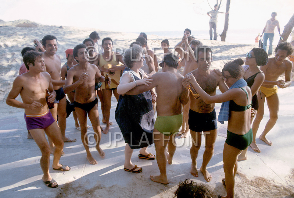 June, 1977. Havana, Cuba. Eighteen years after the Cuban Revolution the first U.S. tourists were permitted to visit Havana. American tourists on the beach of Santa Maria de la Mare. American tourists dancing with Russian tourists.