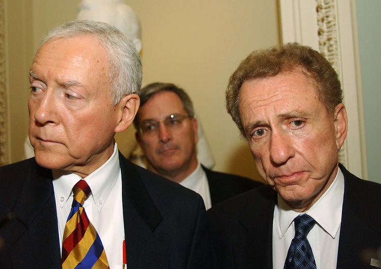 11/16/04.SPECTER/SENATE JUDICIARY--Outgoing Senate Judiciary Chairman Orrin G. Hatch, R-Utah, and Chairman-hopeful Sen. Arlen Specter, R-Pa., talk to reporters after a meeting in the office of Senate Majority Leader Bill Frist with Republican members of the committee. They would not discuss details of the meeting itself, but Hatch said he supports Specter's chairmanship. Specter is opposed for the job by conservative groups concerned about his position on abortion and other social issues..CONGRESSIONAL QUARTERLY PHOTO BY SCOTT J. FERRELL