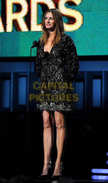 LOS ANGELES, CA - JANUARY 26 : Julia Roberts speaks onstage at The 56th Annual GRAMMY Awards at Staples Center on January 26, 2014 in Los Angeles, California. <br /> CAP/MPI/PG<br /> &copy;PGFMicelotta/MediaPunch/Capital Pictures