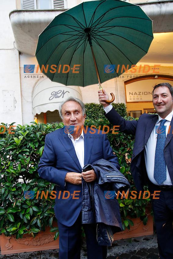 Emilio Fede sotto l'ombrello<br /> Roma 23-09-2015 Capranichetta. Presentazione del libro 'Se tornassi ad Arcore'.<br /> Photo Samantha Zucchi Insidefoto