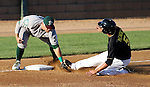 SIOUX FALLS, SD - JULY 2 Carlos Mendez #5 from the Sioux Falls Canaries is out at third as Danny Pulfer #22 from the Gary Southshore Railcats puts the tag on him in the second inning Wednesday night at the Sioux Falls Stadium. (Photo by Dave Eggen/Inertia)