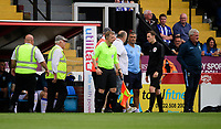 Stewards escort a spectator away from the Sheffield Wednesday dug-out, as Sheffield Wednesday's manager Steve Bruce, right, watches on<br /> <br /> Photographer Chris Vaughan/CameraSport<br /> <br /> Football Pre-Season Friendly - Lincoln City v Sheffield Wednesday - Saturday July 13th 2019 - Sincil Bank - Lincoln<br /> <br /> World Copyright © 2019 CameraSport. All rights reserved. 43 Linden Ave. Countesthorpe. Leicester. England. LE8 5PG - Tel: +44 (0) 116 277 4147 - admin@camerasport.com - www.camerasport.com