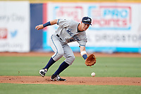 West Michigan Whitecaps second baseman Cameron Warner (4) fields a ground ball during the first game of a doubleheader against the Lake County Captains on August 6, 2017 at Classic Park in Eastlake, Ohio.  Lake County defeated West Michigan 4-0.  (Mike Janes/Four Seam Images)