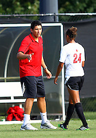 WINSTON-SALEM, NORTH CAROLINA - August 30, 2013:<br />  Assistant coach Andrew Quinn of Louisville University greets Rachel Melhado (24) as she comes off the field against Virginia Tech during a match at the Wake Forest Invitational tournament at Wake Forest University on August 30. The game ended in a 1-1 tie.