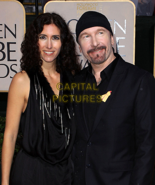 MORLEIGH STEINBERG & THE EDGE (David Howell Evans).67th Golden Globe Awards held Beverly Hilton, Beverly Hills, California, USA..January 17th, 2010.globes half length black suit dress u2 married husband wife hat goatee facial hair.CAP/ADM/KB.©Kevan Brooks/Admedia/Capital Pictures