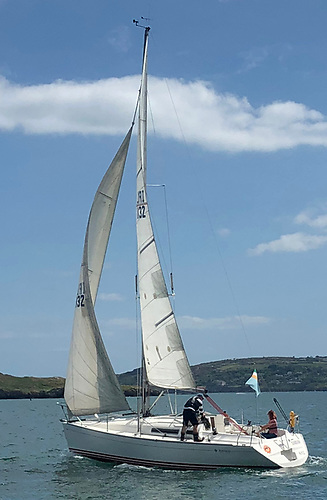 This is 2 metres-plus…….HYC Commodore Ian Byrne on the genoa winch, and Lea O'Donoghue on the helm