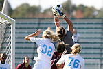 09 November 2008: Virginia Tech's Kristin Carden (in gray) grabs the ball over North Carolina's Kristi Eveland (32) and Ali Hawkins (76). The University of North Carolina Tarheels defeated the Virginia Tech University Hokies 3-0 at WakeMed Stadium at WakeMed Soccer Park in Cary, NC in the women's ACC tournament championship game.