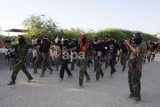 Palestinian militants of the Popular Front for the Liberation of Palestine (PFLP) train during a military exercise in Nusseirat in the central Gaza Strip on August 2, 2009.   Photo by Ashraf amra