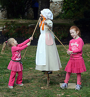 FAIRLESS HILLS, PA -  OCTOBER 19:  From left, Charlotte Morgan, 3, and her sister Hannah Morgan,7 of Levittown, Pennsylvania make Polly-Play-With-Me move during the 300 Anniversary celebration of the Three Arches October 19, 2013 -  Fairless Hills, Pennsylvania. (Photo by William Thomas Cain/Cain Images)