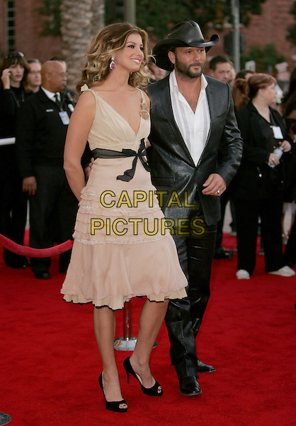 FAITH HILL & TIM McGRAW.The 33rd Annual American Music Awards held at The Shrine Auditorium in Los Angeles, California.  .November 22nd, 2005.Ref: DVS.AMA's full length married husband wife blue suit hat peach dress black ribbon belt.www.capitalpictures.com.sales@capitalpictures.com.Supplied By Capital PIctures