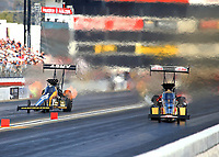 Nov 11, 2017; Pomona, CA, USA; NHRA top fuel driver Leah Pritchett (right) races alongside Tony Schumacher during qualifying for the Auto Club Finals at Auto Club Raceway at Pomona. Mandatory Credit: Mark J. Rebilas-USA TODAY Sports
