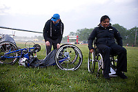 Shawn and Minda set up Minda's handcycle and racing wheelchair in the bicycle and running transition area at the New Jersey Devilman Triathlon on May 5, 2012 in Cumberland County, New Jersey.