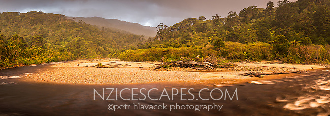 Rainy sunset over Kohaihai River near Karamea, Kahurangi National Park, Buller Region, West Coast, New Zealand, NZ