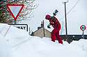 02/03/18<br /> <br /> Ben Lester shovels snow from a  snow drift that closed a road in Sparrowpit near Buxton in the Derbyshire Peak District.<br />   <br /> All Rights Reserved F Stop Press Ltd. +44 (0)1335 344240 +44 (0)7765 242650  www.fstoppress.com