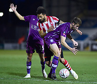 Lincoln City's Bruno Andrade gets between Carlisle United's Anthony Gerrard, left, and Jack Sowerby<br /> <br /> Photographer Andrew Vaughan/CameraSport<br /> <br /> The Emirates FA Cup Second Round - Lincoln City v Carlisle United - Saturday 1st December 2018 - Sincil Bank - Lincoln<br />  <br /> World Copyright © 2018 CameraSport. All rights reserved. 43 Linden Ave. Countesthorpe. Leicester. England. LE8 5PG - Tel: +44 (0) 116 277 4147 - admin@camerasport.com - www.camerasport.com