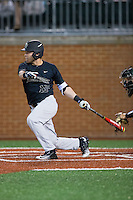 Logan Harvey (15) of the Wake Forest Demon Deacons follows through on his swing against the Charlotte 49ers at Hayes Stadium on March 16, 2016 in Charlotte, North Carolina.  The 49ers defeated the Demon Deacons 7-6.  (Brian Westerholt/Four Seam Images)