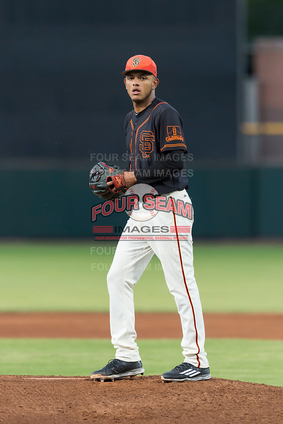 AZL Giants Black starting pitcher Israel Cruz (34) gets ready to deliver a pitch during an Arizona League game against the AZL Rangers at Scottsdale Stadium on August 4, 2018 in Scottsdale, Arizona. The AZL Giants Black defeated the AZL Rangers by a score of 6-3 in the second game of a doubleheader. (Zachary Lucy/Four Seam Images)