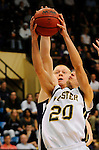 19 MAR 2011: CenterJosh Pedretti (50) of St. Thomas blocks the shot of Ryan Snyder (20) of Wooster during the Division III Men's Basketball Championship held at the Salem Civic Center in Salem, VA. The University of St. Thomas (Minnesota) defeated College of Wooster 78-54 to win the national title.  Andres Alonso/NCAA Photos