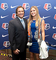 #2 overall pick Kealia Ohai of the Houston Dash stands with head coach Randy Waldrum during the NWSL draft at the Pennsylvania Convention Center in Philadelphia, PA, on January 17, 2014.