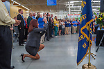 Westerville Chamber of Commerce president Janet Tressler photographs opening ceremonies for the Walmart in Westerville, Ohio.