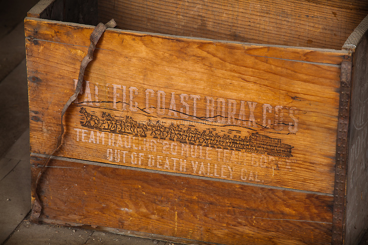 A wooden box used to haul supplies for the Pacific Coast Borax Company is on display in the Boone Store and Warehouse, one of fewer than 170 structures remaining in the ghost town of Bodie (less than 5% of the original buildings). Gold discovered here in 1859. Designated National Historic Landmark in 1961; 1962 it became Bodie State Historic Park. Bodie named California's official state gold rush ghost town. Historic District, California State Park. Mono County, CA.