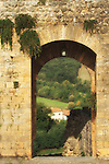 Archway overlooking the Tuscan countryside in Italy.<br />