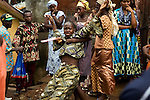 The women watch and scream as Mommy's body is taken away for burial ..Mommy delivered and died from postpartum bleeding at the PCMH (Princess Christian Memorial Hospital). Freetown, Sierra leone.
