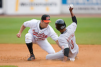 Shortstop Robert Stevens (30) of the Bluefield Orioles applies the tag to Devon Torrence (3) of the Greeneville Astros at Bowen Field in Bluefield, WV, Sunday July 6, 2008. (Photo by Brian Westerholt / Four Seam Images)
