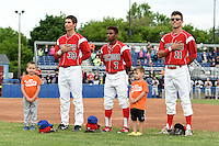 """Batavia Muckdogs players Eric Fisher (33), Mason Davis (7), and Aaron Blanton (11) stand for the national anthem with young fans as part of the """"Stars of the Game"""" promotion before a game against the Mahoning Valley Scrappers on June 20, 2014 at Dwyer Stadium in Batavia, New York.  Batavia defeated Mahoning Valley 7-4.  (Mike Janes/Four Seam Images)"""