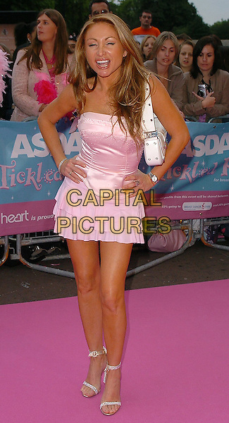 "SAM RAMPLING.Arrivals at ASDA's ""Tickled Pink"" charity concert held at The Royal Albert Hall,.London, 18th September 2005,.full length pink satin corset top mini skirt strappy dimante high heels sandals hands hips.Ref: CAN.www.capitalpictures.com.sales@capitalpictures.com.©Capital Pictures"