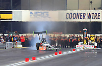 Feb 11, 2017; Pomona, CA, USA; NHRA top fuel driver Clay Millican goes sideways during qualifying for the Winternationals at Auto Club Raceway at Pomona. Mandatory Credit: Mark J. Rebilas-USA TODAY Sports