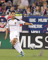 Los Angeles Galaxy defender Omar Gonzalez (4) passes the ball. In a Major League Soccer (MLS) match, the Los Angeles Galaxy defeated the New England Revolution, 1-0, at Gillette Stadium on May 28, 2011.