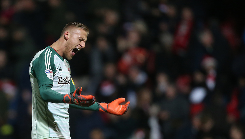 Brentford's Daniel Bentley celebrates at the end of the game<br /> <br /> Photographer Rob Newell/CameraSport<br /> <br /> The EFL Sky Bet Championship - Brentford v Bolton Wanderers - Saturday 22nd December 2018 - Griffin Park - Brentford<br /> <br /> World Copyright © 2018 CameraSport. All rights reserved. 43 Linden Ave. Countesthorpe. Leicester. England. LE8 5PG - Tel: +44 (0) 116 277 4147 - admin@camerasport.com - www.camerasport.com
