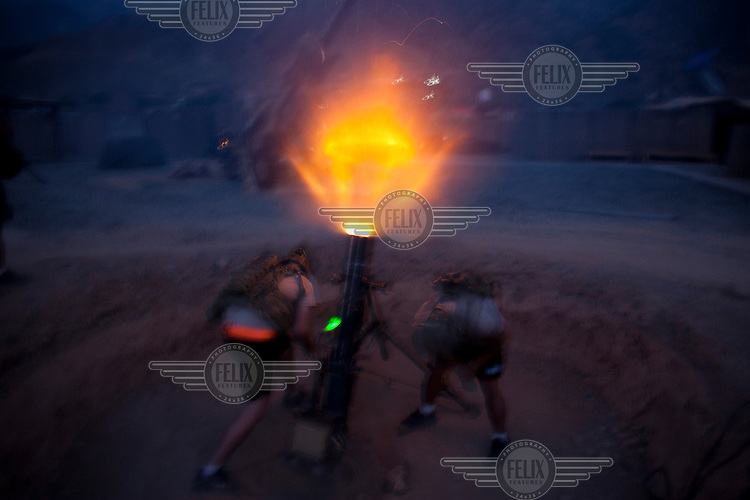 US Army soldiers from 2nd Battalion, 27th Infantry fire a 120mm mortar round from Forward Operating Base (FOB) Bostick...
