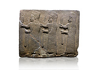 Hittite monumental relief sculpted orthostat stone panel of a Procession. Basalt, Karkamıs, (Kargamıs), Carchemish (Karkemish), 900-700 B.C.  Marching female figures. Anatolian Civilisations Museum, Ankara, Turkey.<br /> <br /> It is a depiction of three marching female figures in long dress with a high headdress at their head. These women are considered to be the nuns of the Goddess Kubaba. They have a bunch of Spica in their right hand, and objects similar to a sceptre in their left hand. <br /> <br /> Against a white background.