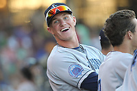 Lake County Captains outfielder Jordan Smith #39 smiles in the dugout during a game against the Dayton Dragons at Fifth Third Field on June 25, 2012 in Dayton, Ohio. Lake County defeated Dayton 8-3. (Brace Hemmelgarn/Four Seam Images)