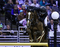 OMAHA, NEBRASKA - APR 2: Romain Duguet rides 	Twentytwo des Biches during the Longines FEI World Cup Jumping Final at the CenturyLink Center on April 2, 2017 in Omaha, Nebraska. (Photo by Taylor Pence/Eclipse Sportswire/Getty Images)