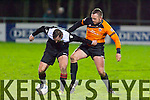 Andy Murphy,Tralee Dynamos has a good look at the ball while David Doyle,Park,tries to move in when the sides met in the Kerry Area,Munster Junior Cup Final last Saturday night at Mounthawk.Dynamos won 2-1 after extra time.