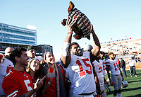 Ohio State Buckeyes running back Ezekiel Elliott (15) celebrates with the Illibuck trophy after the college football game between the Ohio State Buckeyes and the Illinois Fighting Illini at Memorial Stadium in Champaign, Ill., Saturday morning, November 14, 2015. The Ohio State Buckeyes defeated the Illinois Fighting Illini 28 - 3. (The Columbus Dispatch / Eamon Queeney)