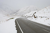Late spring snow covers the hills of the Lindis Pass, Waitaki District, Canterbury, South Island, New Zealand.